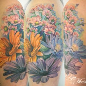 Flower color upper arm tattoo